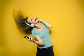 Girl listening to music on Android