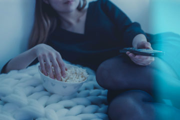 CouchTuner - Eating Popcorn in Bed